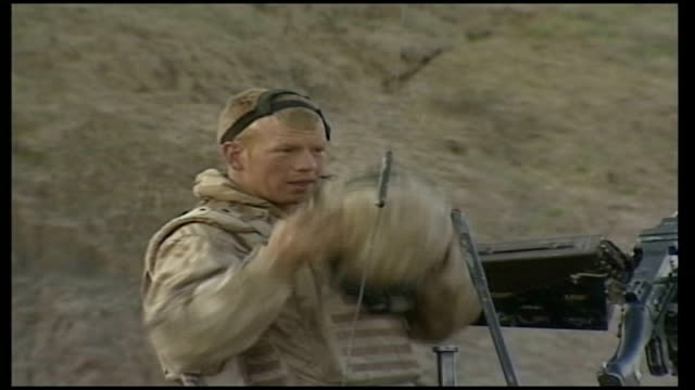 army reviews prince harry's possible deployment to iraq british soldiers checking gun on top of armoured vehicle british soldier as puts on helmet... - army helmet stock videos & royalty-free footage
