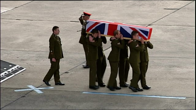 army reviews prince harry's possible deployment to iraq; wiltshire: raf lyneham: ext 'last post' heard sot as soldiers carry coffins decorated with... - union army stock videos & royalty-free footage