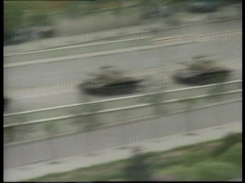 army revolt reports d ext/dawn china beijing tgv skyline tms lorry load troops of 27th army rl as sound of gunfire sof tgv line 27th army tanks... - tiananmen square stock videos & royalty-free footage