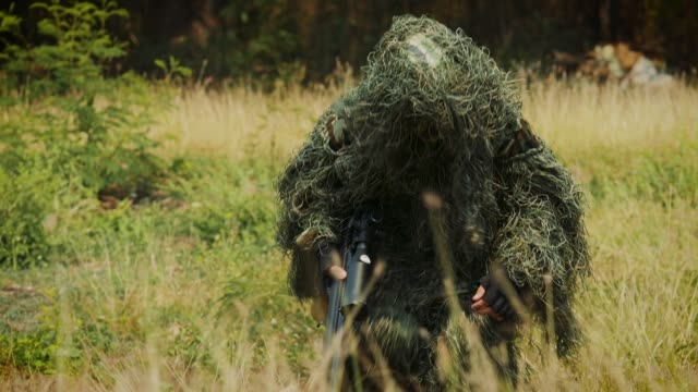 army sniper military operation battle looking through the scope in the field - special forces stock videos & royalty-free footage