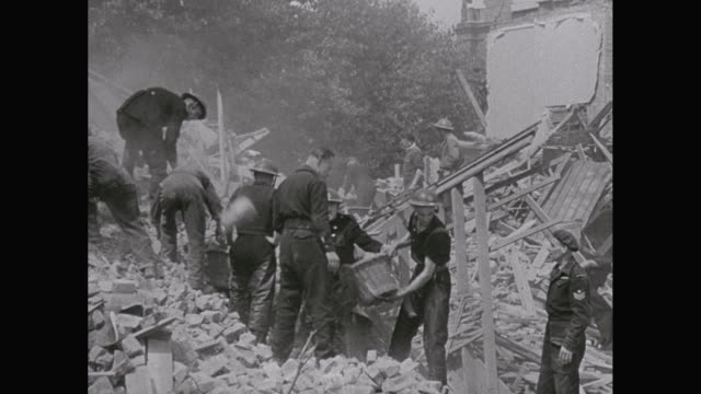stockvideo's en b-roll-footage met ws tu pan army soldier clearing bomb damage during london blitz / london, england, united kingdom - tweede wereldoorlog