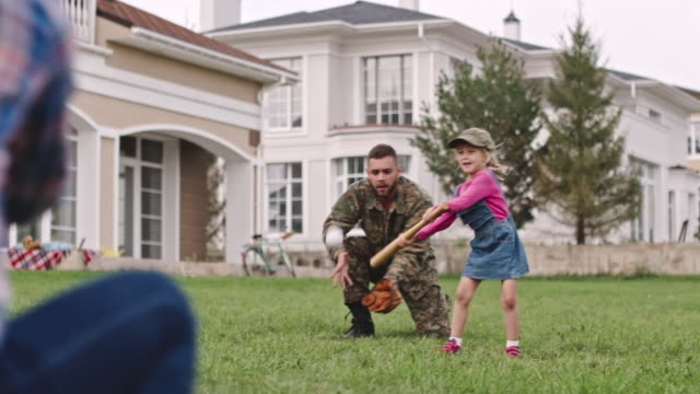 Army soldier enjoying family baseball