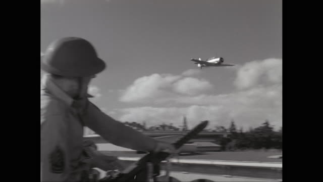 ws ts army soldier firing on fighter plane using machine gun / united states - pearl harbor stock videos and b-roll footage