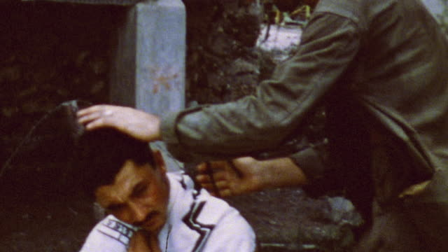 s army soldier giving haircut to fellow soldier / saipan mariana islands - mariana islands stock videos and b-roll footage