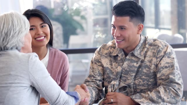 army soldier greets mental health professional - military uniform stock videos & royalty-free footage