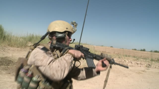 army soldier holds gun during war in afghanistan - afghan national army stock videos & royalty-free footage