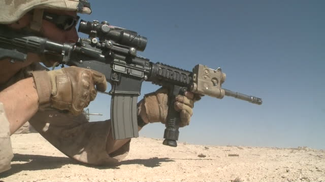 army soldier holds gun during war in afghanistan - war or terrorism or military点の映像素材/bロール