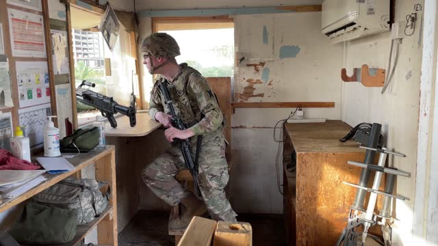 army soldier looks onto baghdad from a guardhouse on the perimeter of the international zone on may 30 in baghdad, iraq. coalition forces based in... - baghdad stock videos & royalty-free footage