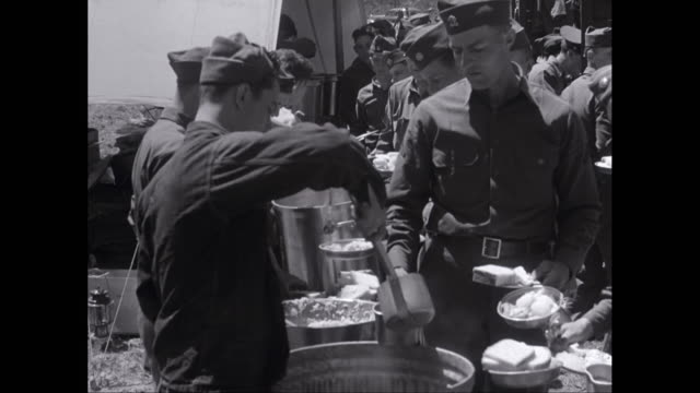 ms army soldier serving food in military camp / united states - military camp stock videos & royalty-free footage