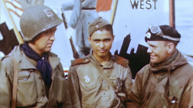 army soldier talking to soviet army soldiers in front of a campaign sign / torgau, germany - 1945 stock videos & royalty-free footage