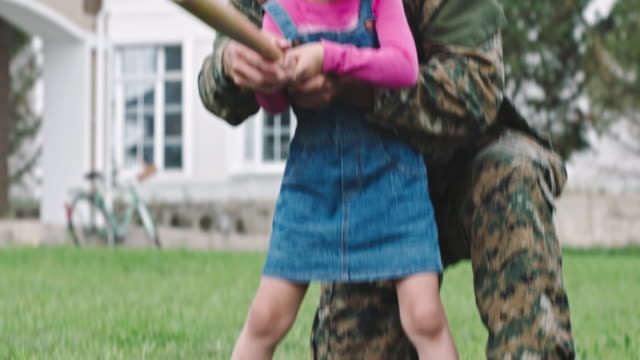 army soldier teaching daughter to play baseball - armed forces stock videos & royalty-free footage