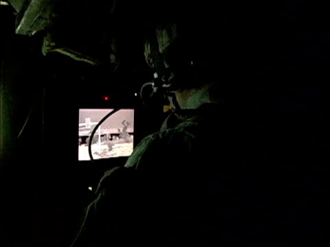 army soldier watching monitor screen inside stryker vehicle while driving down road / baghdad iraq / audio - 2007 stock videos & royalty-free footage