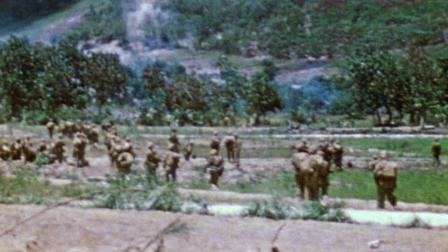 s army soldiers advancing toward smoke covered mountain / saipan mariana islands - mariana islands stock videos and b-roll footage