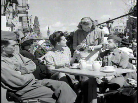 army soldiers and civilians sitting at an outdoor cafe / berlin germany - 1945 stock-videos und b-roll-filmmaterial