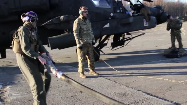 us army soldiers assigned to 12th combat aviation brigade and us marines conduct a jointrefueling mission involving ah64 apache attack helicopters... - apache helicopter stock videos and b-roll footage
