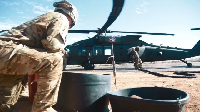 us army soldiers assigned to 227th composite supply company 101st airborne division conduct a refueling mission with uh60 blackhawk helicopter in... - 101st airborne division stock videos & royalty-free footage
