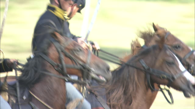 U.S. Army soldiers charge on galloping horses during Custer's Last Stand.