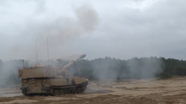 army soldiers conduct a live fire exercise with paladin self-propelled howitzers at torun, poland, may 15, 2019 - howitzer stock videos & royalty-free footage