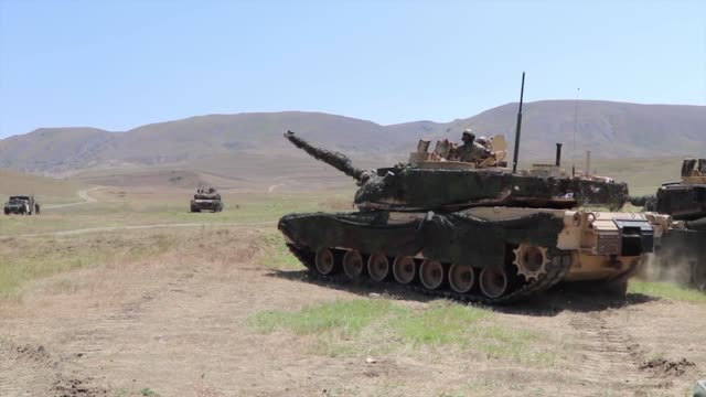 army soldiers conduct a tank range during agile spirit 19 in orpholo, georgia, 1 august 2019. - portello video stock e b–roll