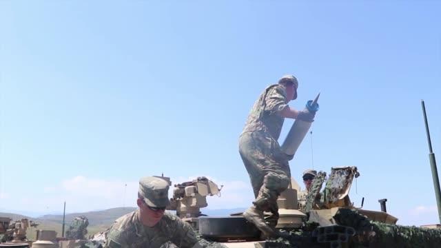 army soldiers conduct a tank range during agile spirit 19 in orpholo, georgia, 1 august 2019. - 酋長点の映像素材/bロール