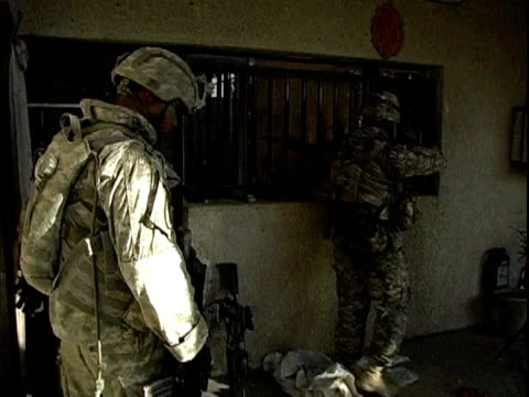 army soldiers entering house during patrol / baghdad, iraq / audio - 2007 stock videos & royalty-free footage