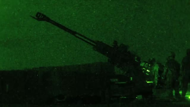 army soldiers fire a m777 howitzer at night from qayyarah west airfield, iraq to disrupt known enemy positions, 10 may 2019. - howitzer stock videos & royalty-free footage