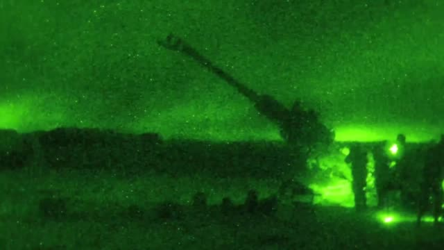 us army soldiers fire a m777 howitzer at night from qayyarah west airfield iraq to disrupt known enemy positions 10 may 2019 - night vision stock videos and b-roll footage