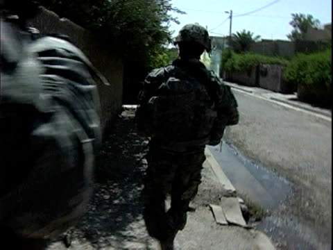 army soldiers firing smoke bomb and patrolling street / baghdad iraq / audio - 2007 stock videos & royalty-free footage
