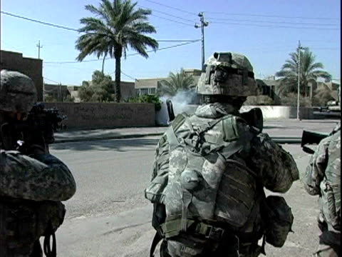 army soldiers firing smoke bomb and patrolling street / baghdad, iraq / audio - 2007 stock videos & royalty-free footage