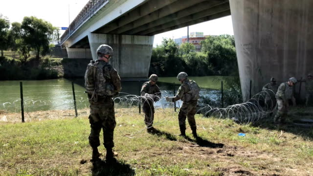 US Army soldiers from Ft Riley Kansas install protective wire along the Rio Grande at the USMexico border on November 2 2018 in Hidalgo Texas US...