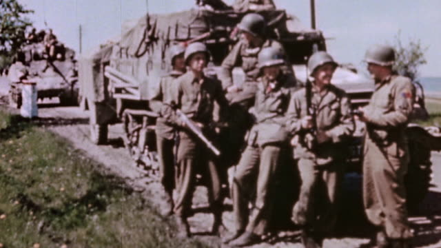 s army soldiers guarding a road leaning against truck and talking while civilians carrying possessions leave the city / pilsen czech republic - 1945 stock videos & royalty-free footage