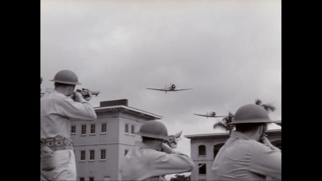 ws pan army soldiers holding rifle and aiming on wwii fighter plane / united states - pearl harbor stock videos and b-roll footage