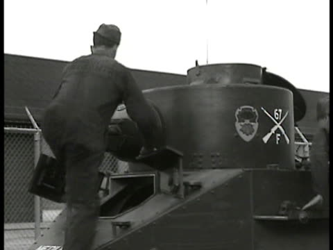 army soldiers in uniform responding to 'call to arms' soldiers running up stairs climbing in tank riding train horses led into trailers search light... - 1935 stock-videos und b-roll-filmmaterial