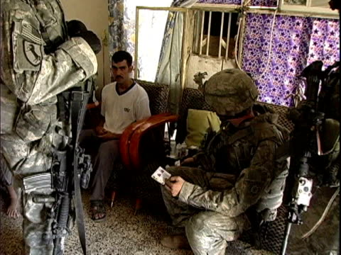 army soldiers interrogating man in his home during patrol / baghdad, iraq / audio - cavalry stock videos & royalty-free footage