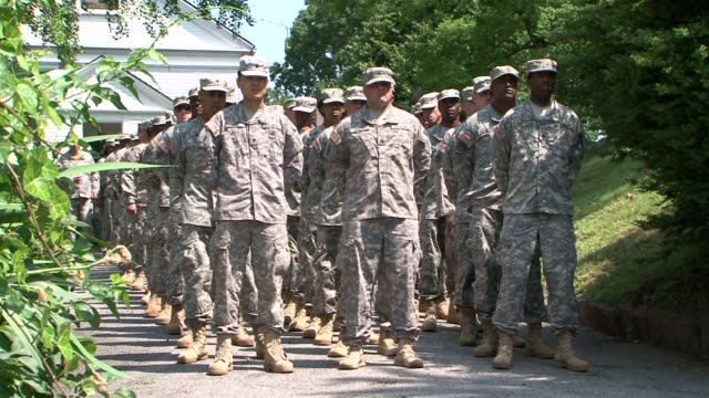 army soldiers leaving interfaith service on may 28, 2012 in queens, new york, just before the 82nd annual little neck-douglaston memorial day parade... - religious service stock videos & royalty-free footage