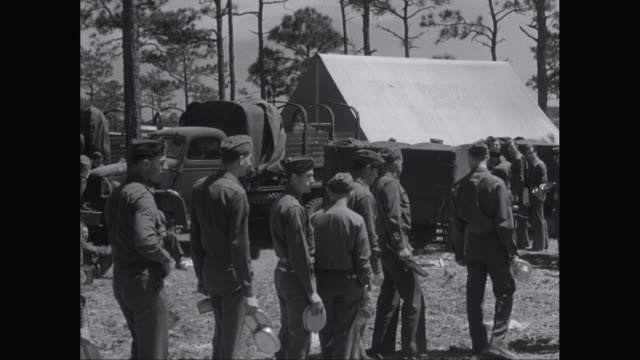 ms pan army soldiers line up for food in military camp / united states - military camp stock videos & royalty-free footage