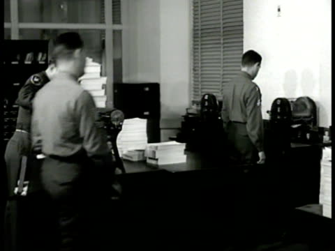 stockvideo's en b-roll-footage met army soldiers making copies at mimeograph machine carrying papers out of copy office cu paper from secretary of war henry stimson to general... - ministerie van defensie