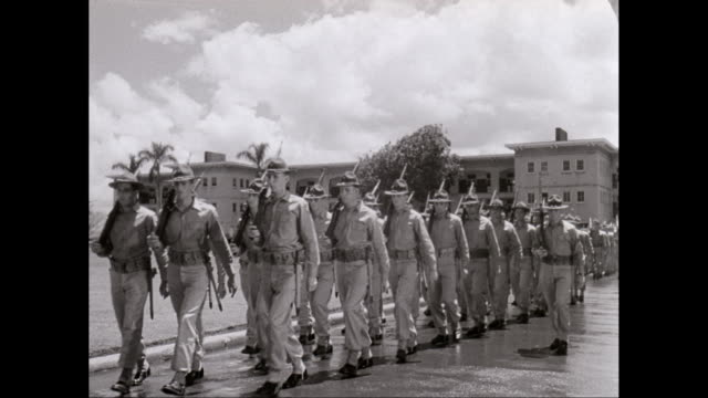 WS PAN Army soldiers marching at military building, new soldier inquiring / Hawaii, United States