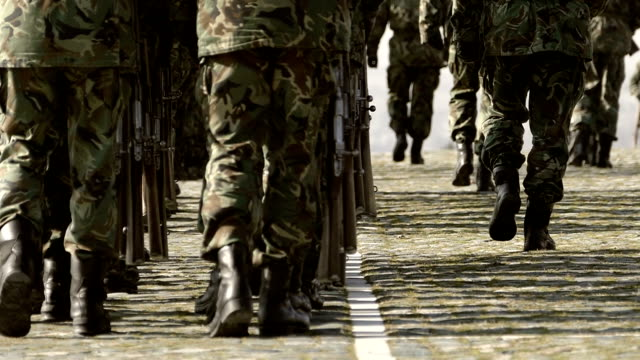 army soldiers marching in camouflage uniform-slowmotion - army exercise stock videos and b-roll footage