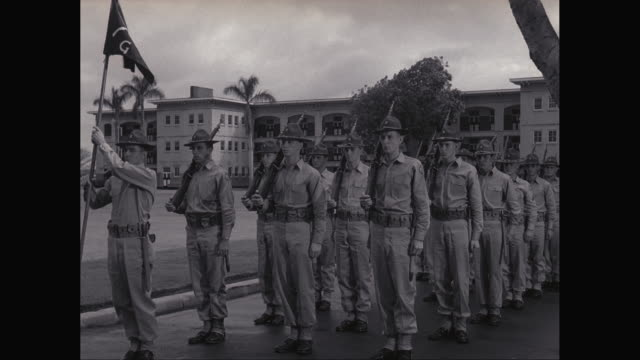 ws pan army soldiers marching near military building / united states - marching stock videos & royalty-free footage