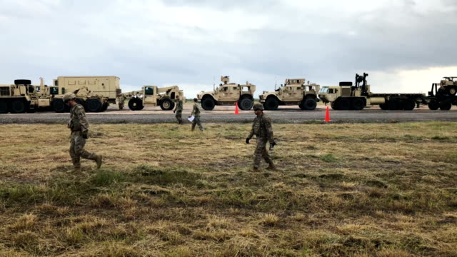 Army soldiers move to another location near the USMexico border on November 4 2018 in Donna Texas President Trump ordered the troops to border areas...