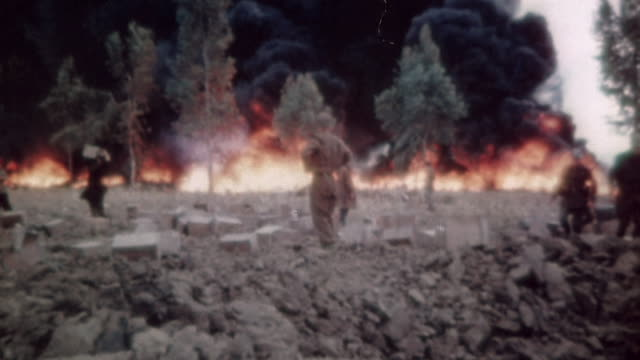 S Army Soldiers observing large fire raging at a gasoline dump with huge clouds of black smoke / Tunisia