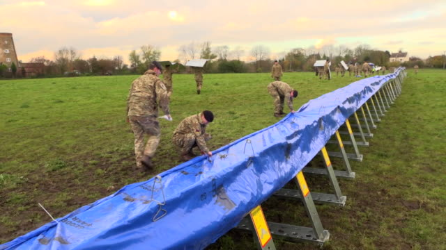 army soldiers reinforce flood defences in the flooded village of fishlake, doncaster - construction frame stock videos & royalty-free footage