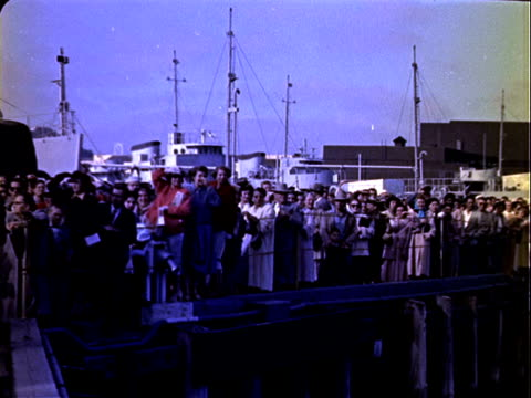 us army soldiers returning home from overseas deployment in korea walking gangplank with luggage and duffel bags / crowd gathered on dock / usns... - korean war stock videos & royalty-free footage