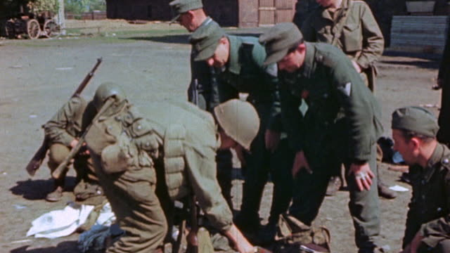 vidéos et rushes de s army soldiers searching and inspecting the belongings of captured german army soldiers during world war ii european campaign / germany¬† - wehrmacht