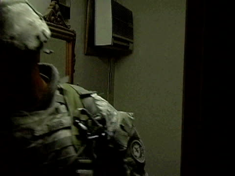 army soldiers searching through dresser drawers in house / baghdad, iraq / audio - searching点の映像素材/bロール