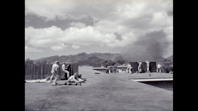 ws army soldiers shooting on building roof shooting at fighter planes as they strafe them / hawaii, united states - pearl harbor stock videos and b-roll footage