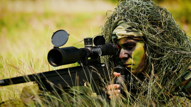 army soldiers sniper with guns during the military operation in the field, war concept - marines stock videos & royalty-free footage