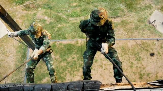 army soldiers training rope climbing at boot camp - abseiling stock videos & royalty-free footage