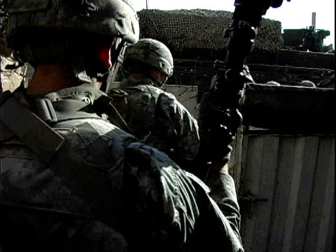army soldiers walking toward stryker vehicle after sniper fire / baghdad iraq / audio - 2007 stock videos & royalty-free footage
